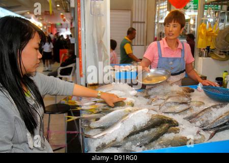 Singapore Little India Serangoon Road Tekka Food Centre & and Market marketplace shopping Asian woman vendor selling - Stock Photo