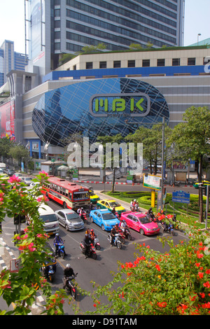 Bangkok Thailand Pathum Wan Phaya Thai Road MBK Center centre complex shopping traffic taxi taxis cabs motorcycles - Stock Photo
