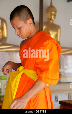 Bangkok Thailand Pom Prap Sattru Phai Wat Saket Ratcha Wora Maha Wihan Buddhist temple inside interior Asian man - Stock Photo