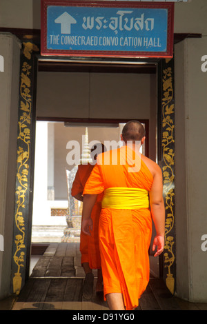 Bangkok Thailand Pom Prap Sattru Phai Wat Saket Ratcha Wora Maha Wihan Buddhist temple Asian man monk robe kasaya - Stock Photo