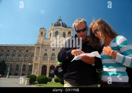 Couple checking the map outside the Kunsthistoriches Museum (Art History Museum), Vienna, Austria. No MR - Stock Photo