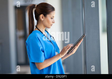 female nurse using tablet computer in hospital - Stock Photo