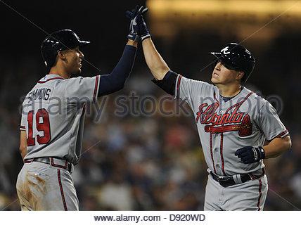 Los Angeles, USA. 8th June, 2013. Atlanta Braves starting pitcher Kris Medlen high fives teammate Andrelton Simmons - Stock Photo