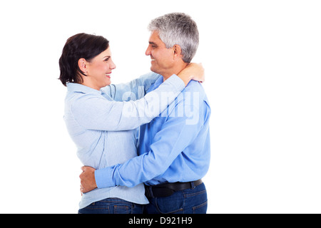 happy and beautiful middle aged couple embracing on white background - Stock Photo