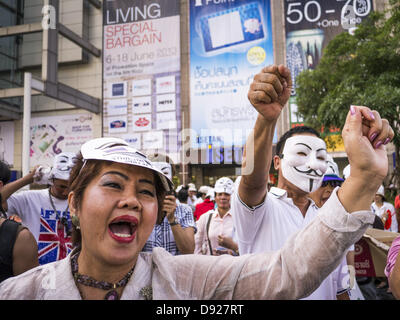 Bangkok, Thailand - June 9, 2013 - Members of the White Mask protest movement gather on the plaza in front of Central - Stock Photo