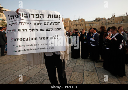 Ultra Orthodox Jews protesting Women Reformists praying in the Western Wall Jerusalem Israel - Stock Photo