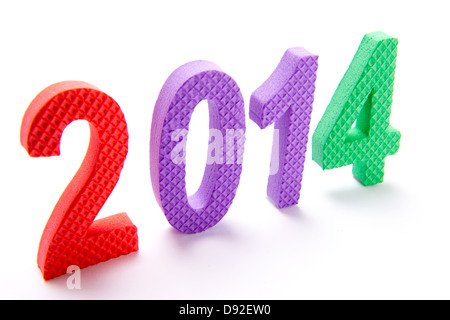 The year 2014 in colorful children's foam letters on angle shown on white background for new year - Stock Photo