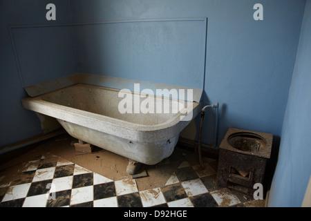 Bathtub in abandoned house, Kolmanskop Ghost Town, near Luderitz, Namibia, Africa - Stock Photo