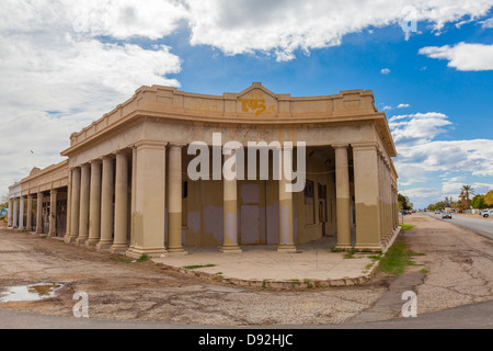 An old bank building built in the classical style sits abandoned on a corner in the Southern California town of - Stock Photo