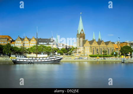 View of the old city of Bremen across the river, Germany - Stock Photo