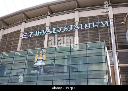 Etihad (formerly the City of Manchester) Stadium, home of Manchester City FC with old crest displayed - Stock Photo