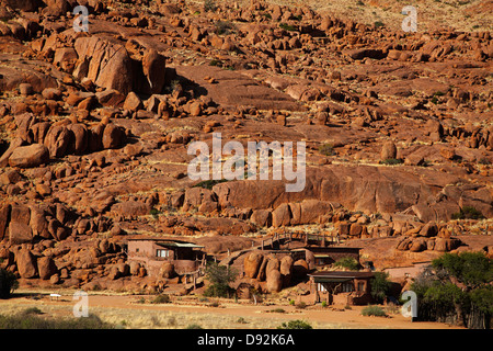 Fest Inn Fels Farm Lodge built into the rocks of Tiras Mountains, Ranch Koiimasis, Southern Namibia, Africa - Stock Photo