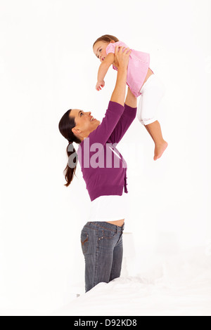 happy mother playing with daughter at home - Stock Photo