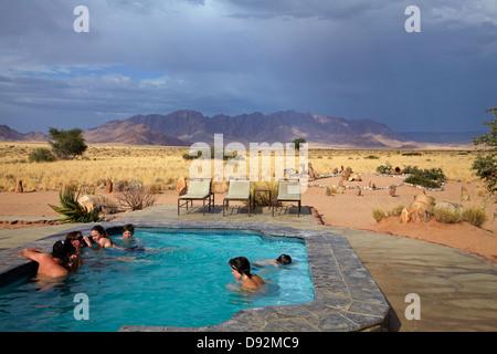 Swimming pool at Desert Camp, Sesriem, Namib Desert, Namibia, Africa - Stock Photo