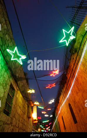 Illuminated decorations hanging along the Armenian Patriarchate street in the Armenian quarter during the Jerusalem - Stock Photo