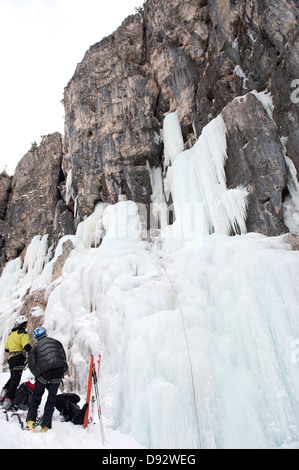 Two skiers prepare for ice climb at Lagazuoi, South Tyrol, Italy - Stock Photo