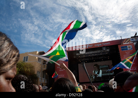 Football fan waves South African flag during live concert as part FIFA world cup final draw festivities on Long - Stock Photo