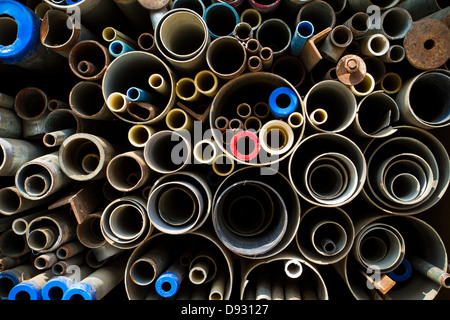 Stacked steel pipes and tubes background - Stock Photo