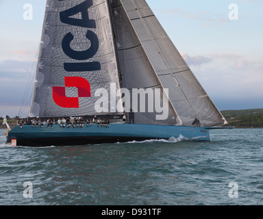 100ft super maxi yacht ICAP Leopard helmed by Mike Slade while sailing round the island race Isle of Wight UK - Stock Photo