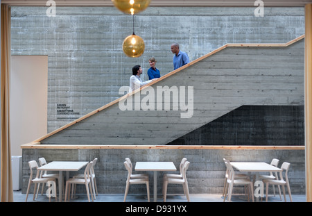 Men and woman talking on stairs - Stock Photo