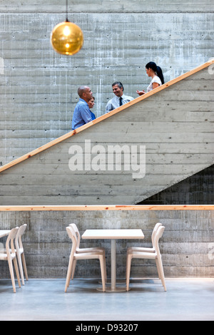 Men and women talking on stairs - Stock Photo