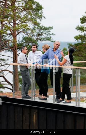 People talking on terrace - Stock Photo