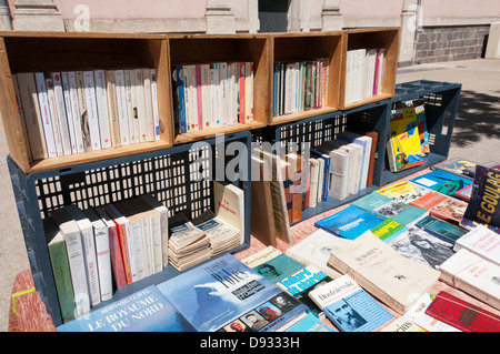 A secondhand book stall on a French market. - Stock Photo