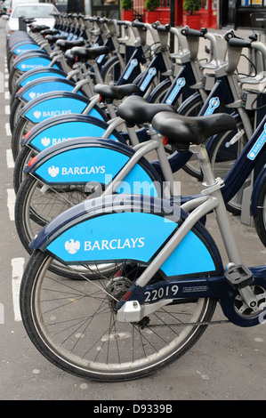 Boris Bikes in Kensington London. Barclays Cycle Hire is a public bicycle sharing scheme in London , England , UK - Stock Photo