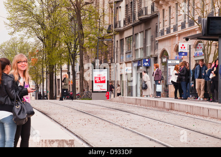 People waiting for the tram in the centre of Dijon, France. - Stock Photo