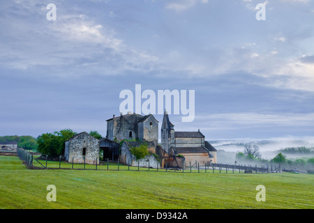 The church and old priory in Sainte Croix de Beaumont in the Dordogne area of France. - Stock Photo
