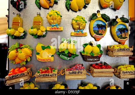 Fridge magnet souvenirs on sale in a tourist gift shop in Sorrento - Stock Photo