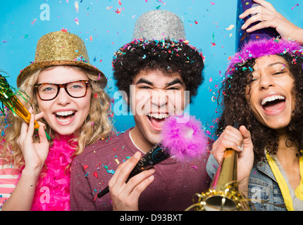 Friends wearing hats at party - Stock Photo