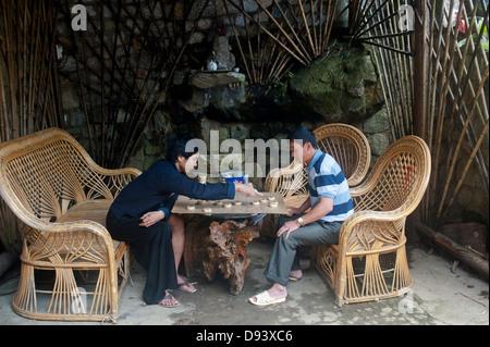 Sapa, Vietnam - Two men playing Chinese chess - Stock Photo