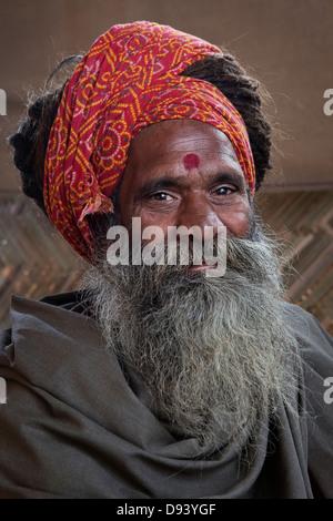 Portrait of a holy man at the Kumbh Mela 2013 in Allahabad, India - Stock Photo