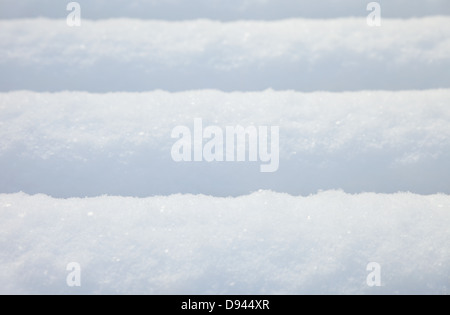 Fresh fluffy snow with some small snow crystals visible - Stock Photo