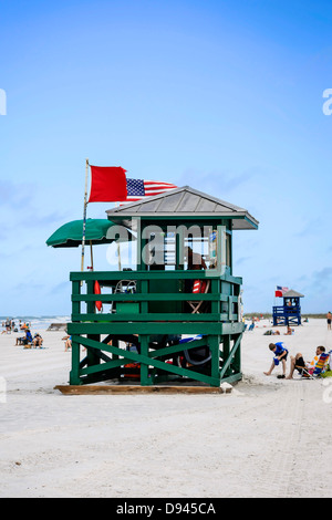 The Lifeguard towers on Siesta Key Beach showing the red flag meaning unsafe to swim - Stock Photo