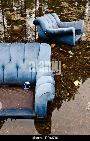 Old armchairs in lake - Stock Photo