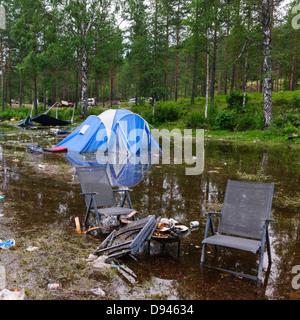 Rubbish around camping site - Stock Photo