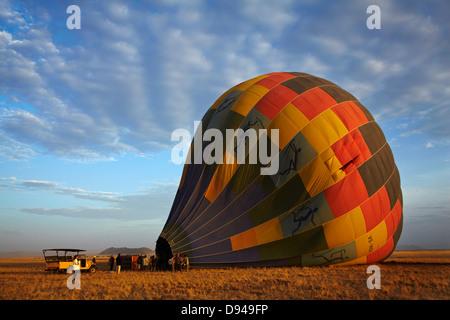 Launching hot air balloon in early light, Namib Desert, near Sesriem, Namibia, Africa - Stock Photo