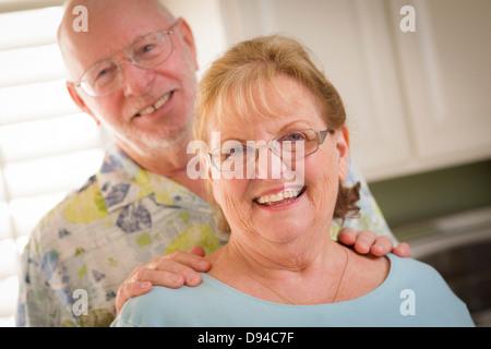 Happy Caucasian Senior Couple Portrait Inside Kitchen. - Stock Photo