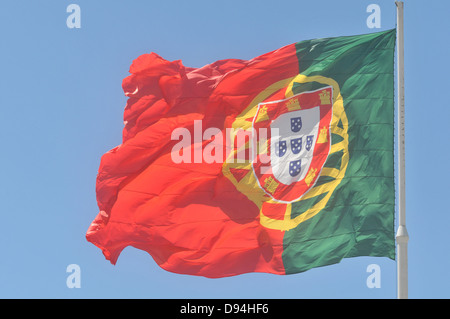 portuguese flag in blue sky Lisbon Portugal - Stock Photo