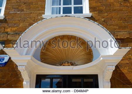 Baroque shell door pediment, Wellingborough, Northamptonshire, England UK - Stock Photo