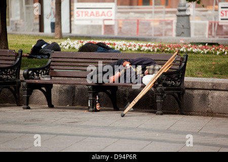 homeless people in a park, moscow, russia - Stock Photo