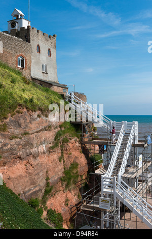 Sidmouth, Devon, England. June 10th 2013. A painter and decorator is painting Jacobs Ladder at Sidmouth. - Stock Photo