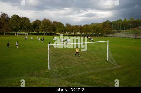 a local football match at the park - Stock Photo