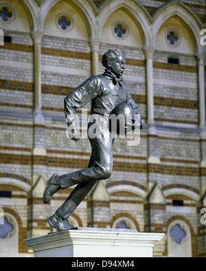 A bronze statue of William Webb Ellis outside Rugby School in Rugby where, in 1823, he invented the game of Rugby - Stock Photo