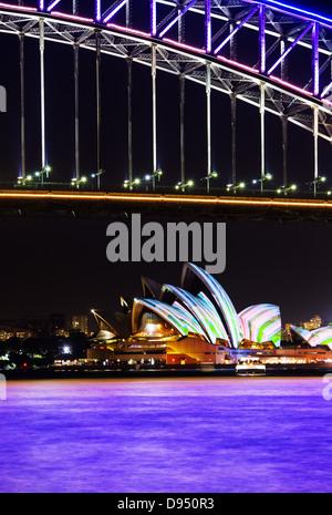Sydney Harbour Bridge and Sydney Opera House at night during the annual Sydney Lighting Festival Vivid - Stock Photo