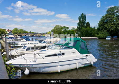 Motorboats moored by the side of the river Thames at Henley-on-Thames Oxfordshire England UK GB EU Europe - Stock Photo
