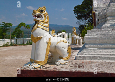 A CHINLE is half lion and half dragon and guards a BUDDHIST SHRINE - HSIPAW, MYANMAR - Stock Photo