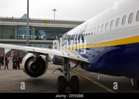 passengers boarding ryanair flight at dublin airport terminal 1 ireland - Stock Photo